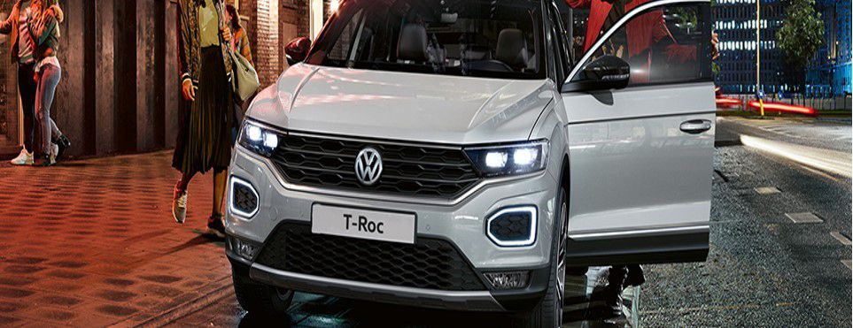 VW T-Roc parked at the side of the road at night