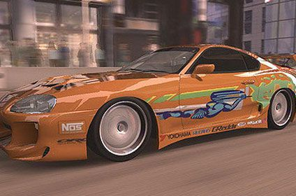 Orange sports car with brightly coloured stickers on the side from the fast & the furious franchise