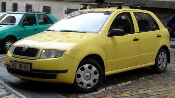 Yellow Skoda Fabia 4 door hatchback