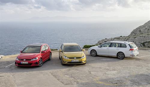 Volkswagen range; red VW Golf, white passat estate