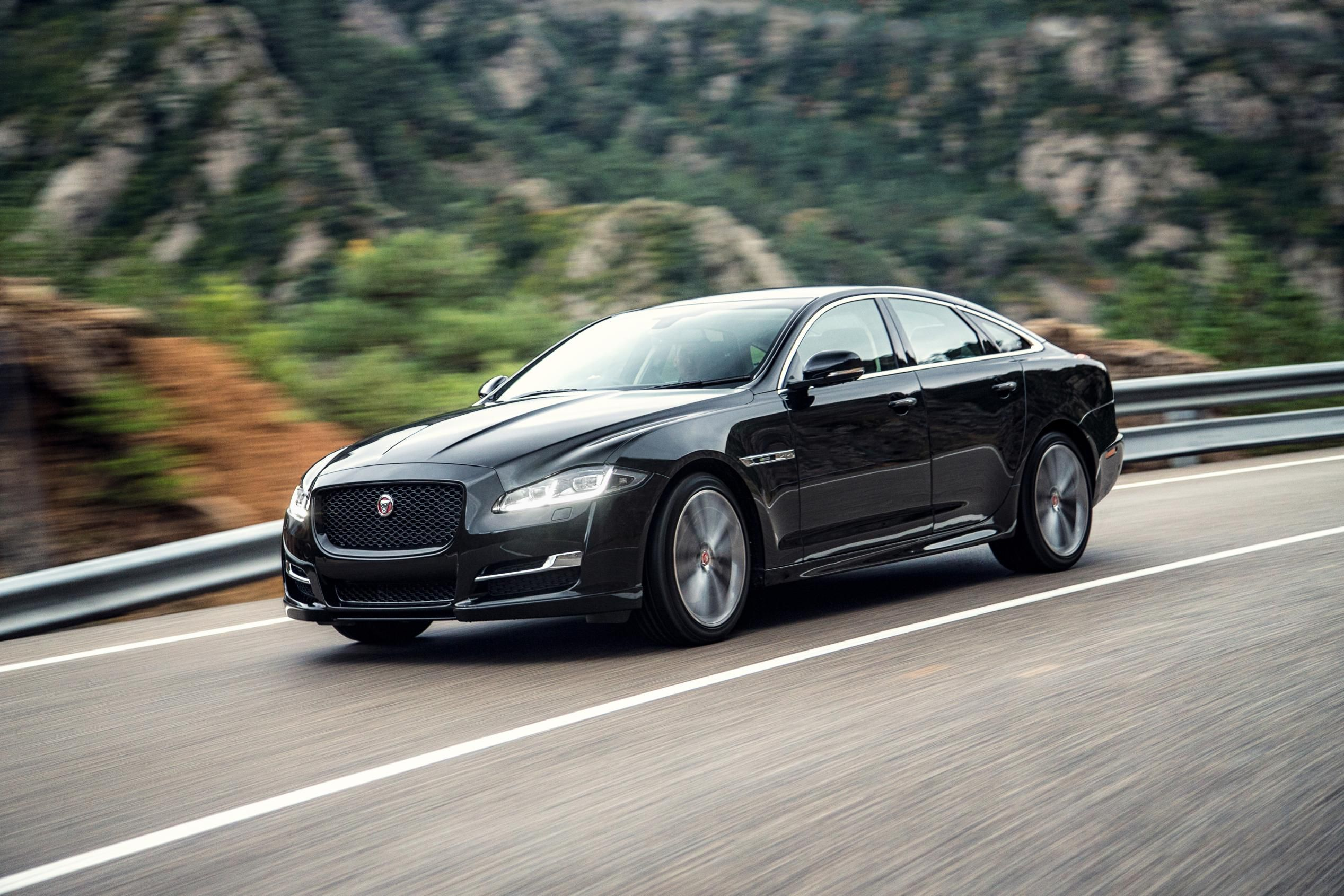 Side view of Jaguar XJ driving on a road