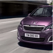 Purple Peugeot 108 driving towards you