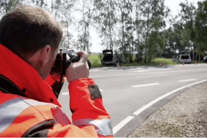 Safety man taking pictures of the road