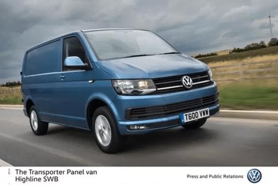 Volkswagen Transporter panel van in metallic blue driving towards you at speed