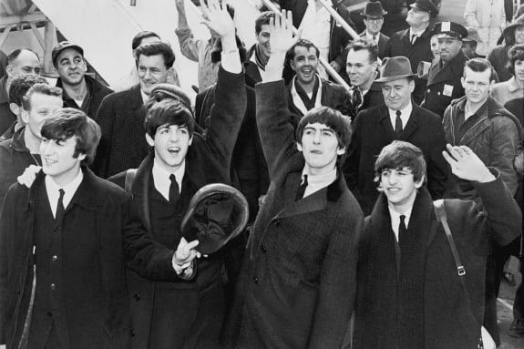 Black and white Beatles arriving in America for first tour in 1964