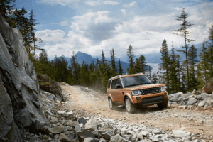 Land Rover Discovery driving up mountain