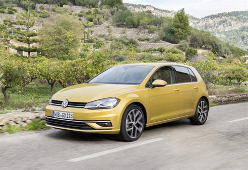 Yellow 5 door Volkswagen Golf