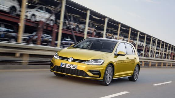 Bright yellow metallic Volkswagen Golf on the move