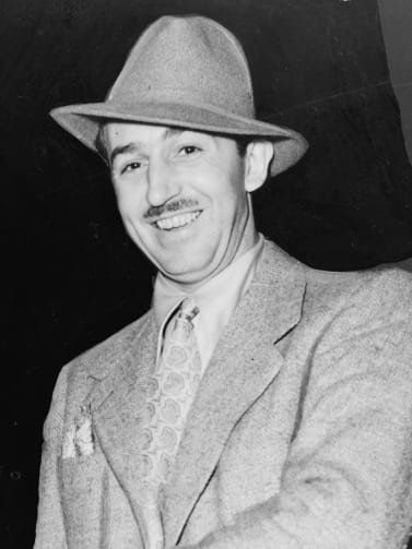 Black and white photograph of man in suit and hat from 1930s