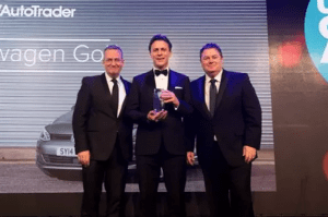 3 men accept the VW Golf's award for best used car of 2016 at the Car Dealer awards