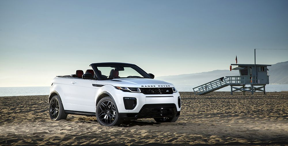 White Range Rover Convertible parked on the beach with roof down
