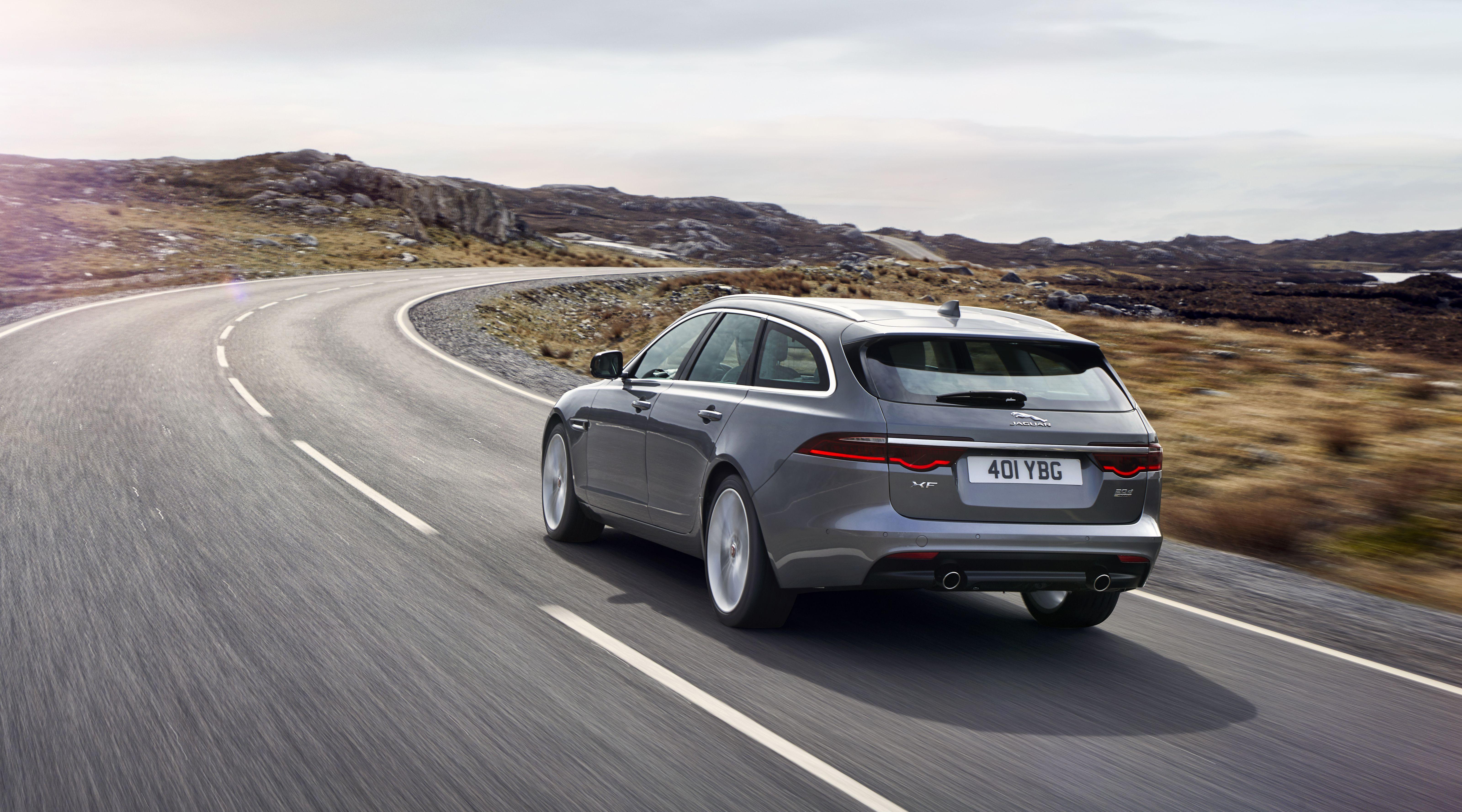 Jaguar XF Sportbrake new estate car driving on road in grey