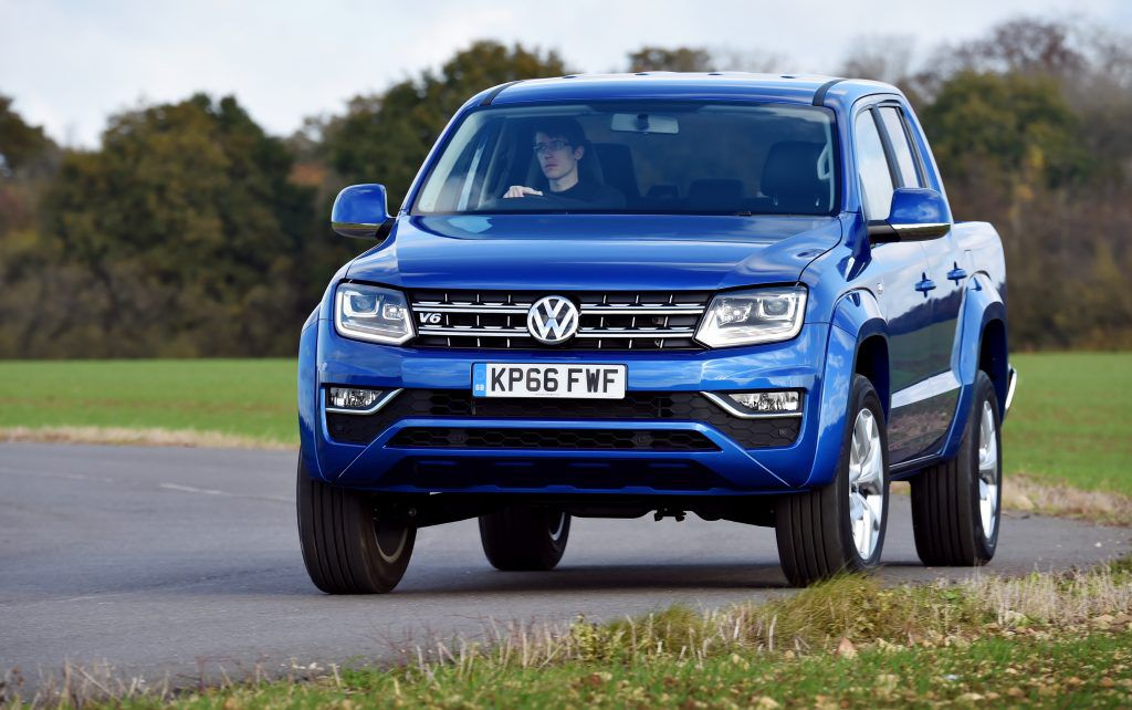 Blue VW Amarok pickup from front on road
