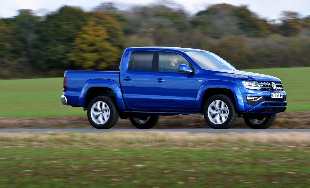 Blue Amarok pickup from side on road