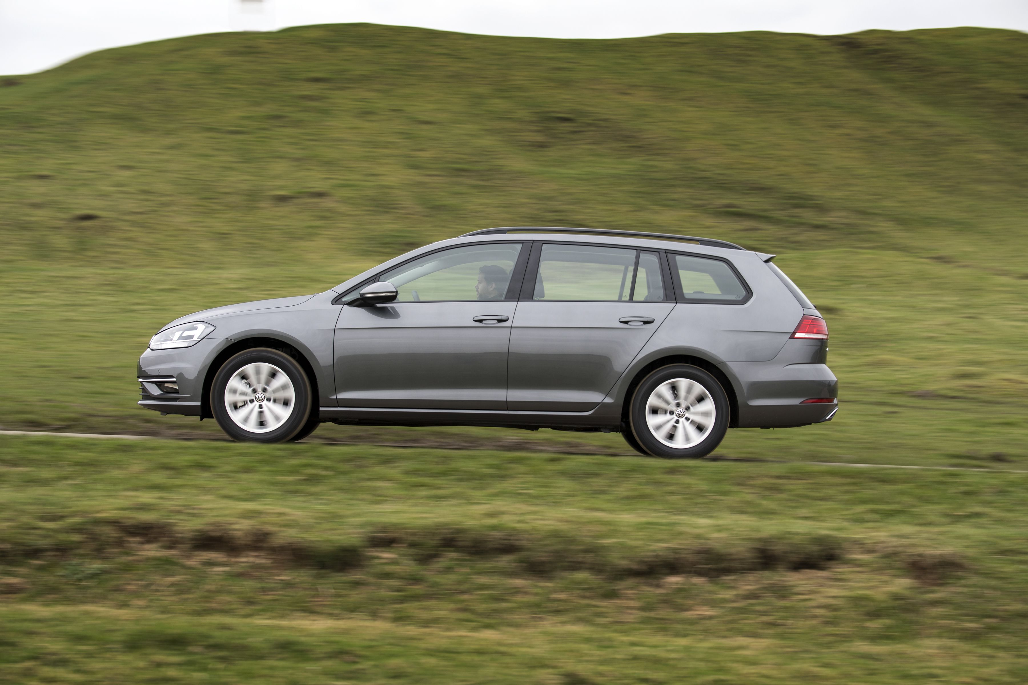 Volkswagen Golf estate speeding across the countryside
