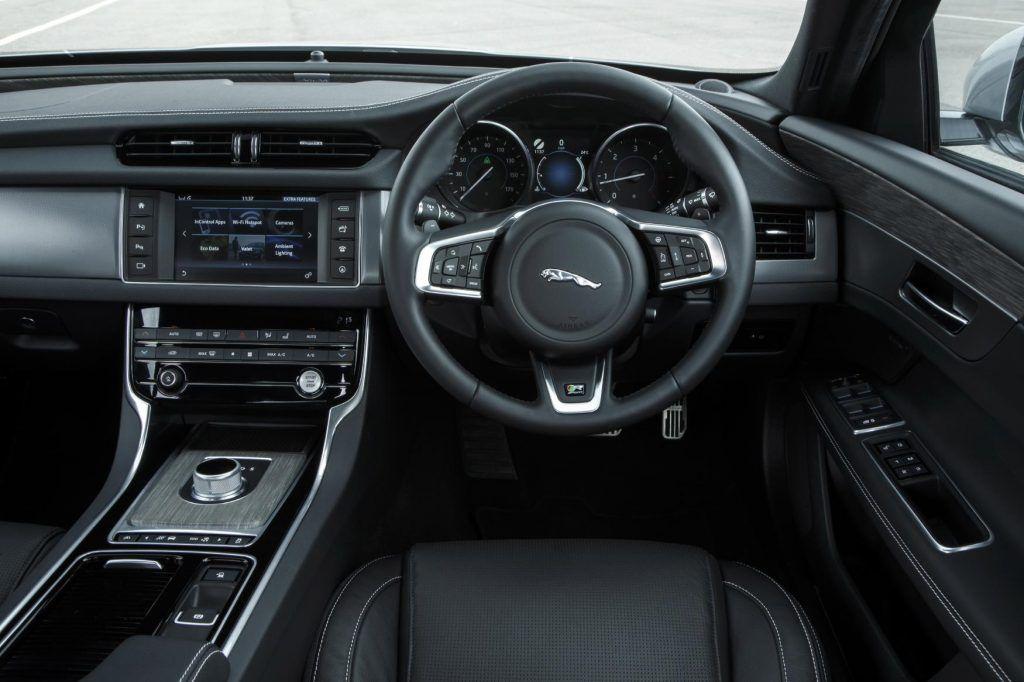 Jaguar XF driving on empty road