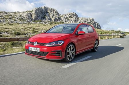 Red Golf GTI driving