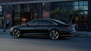 Audi A8 in black parked on street