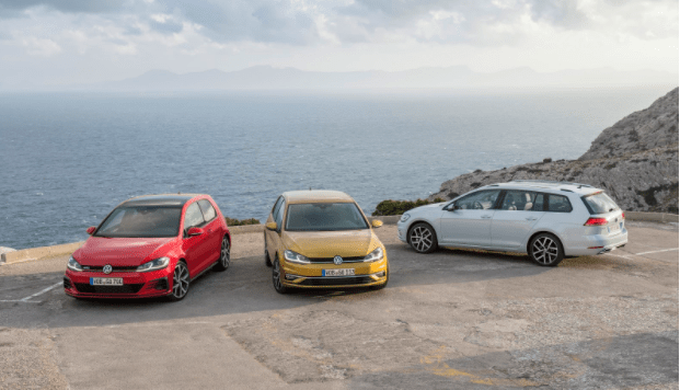 Range of Volkswagen cars; red VW Golf GTI, White Passat Estate