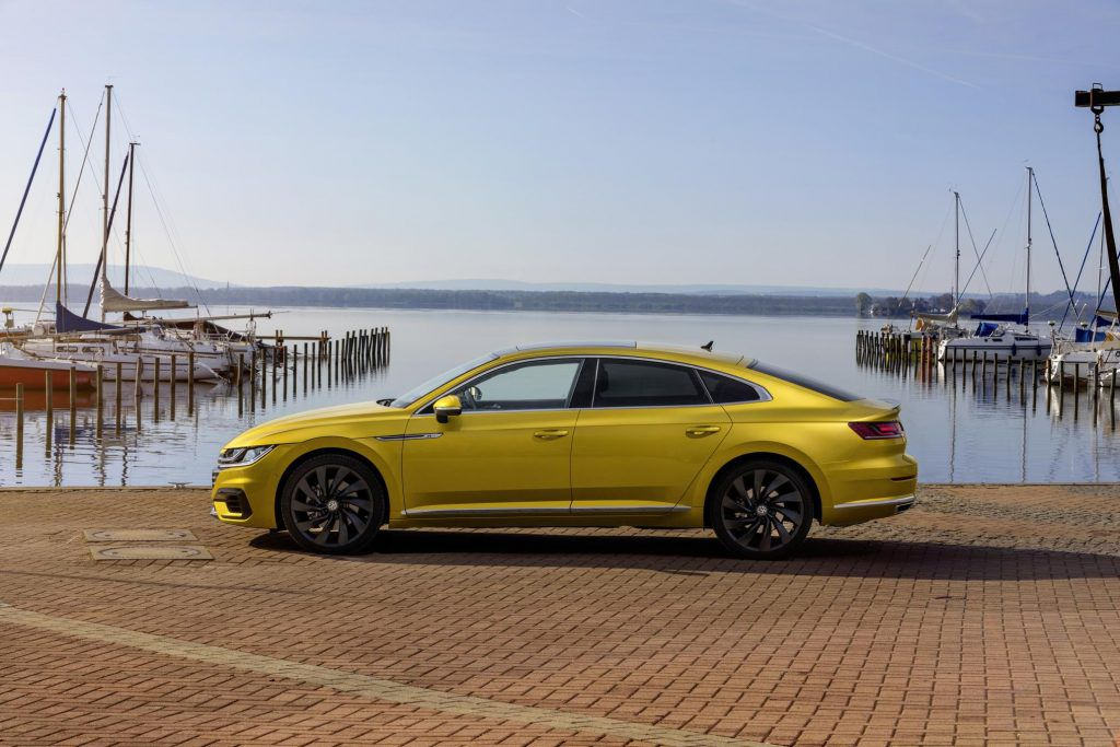 Volkswagen Areon in Turmeric yellow parked at a harbour