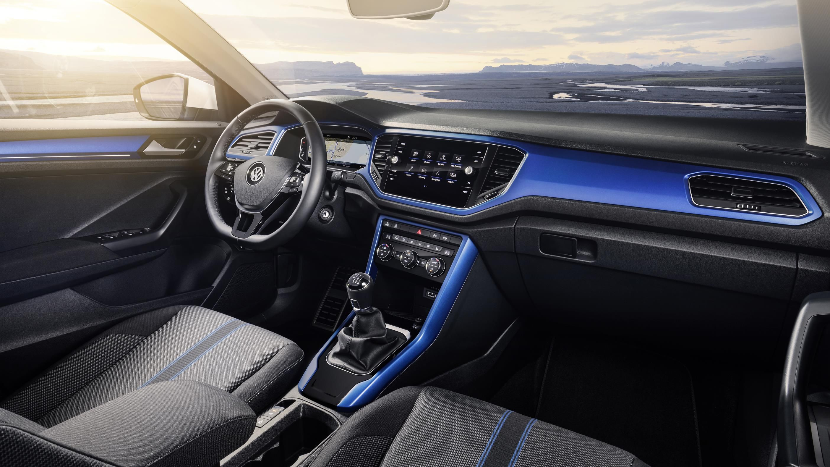 Interior of VW T-Roc SUV with blue trim on dashboard and seats