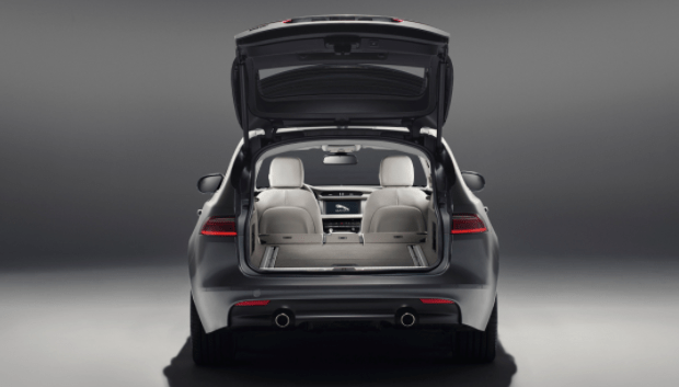 Jaguar XF sportbrake seen from the rear with the hatchback open and back seats down