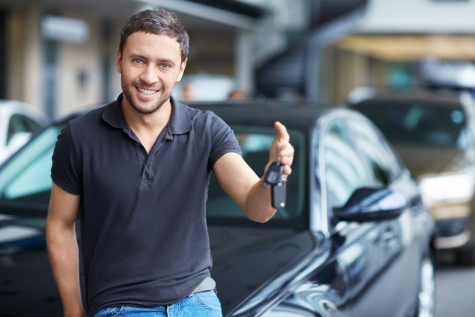 Man in front of new car with car keys
