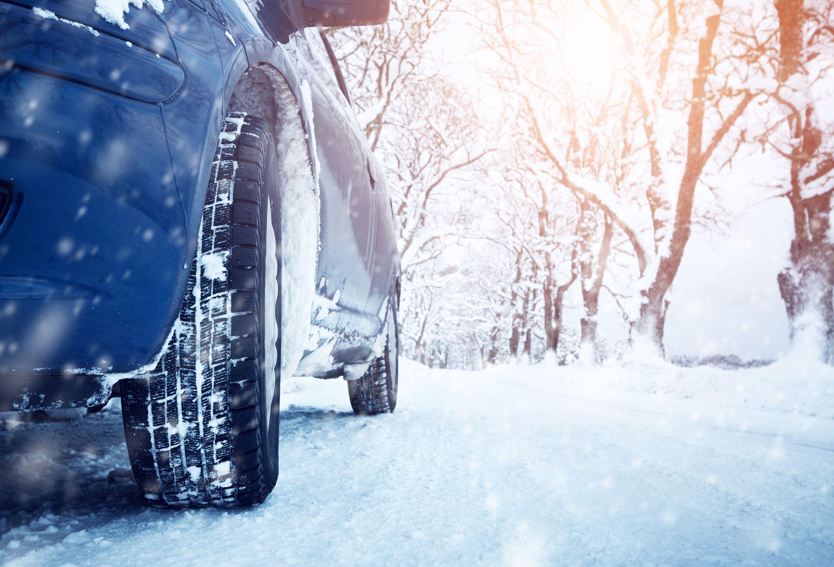 Car parked in winter, snowy scene