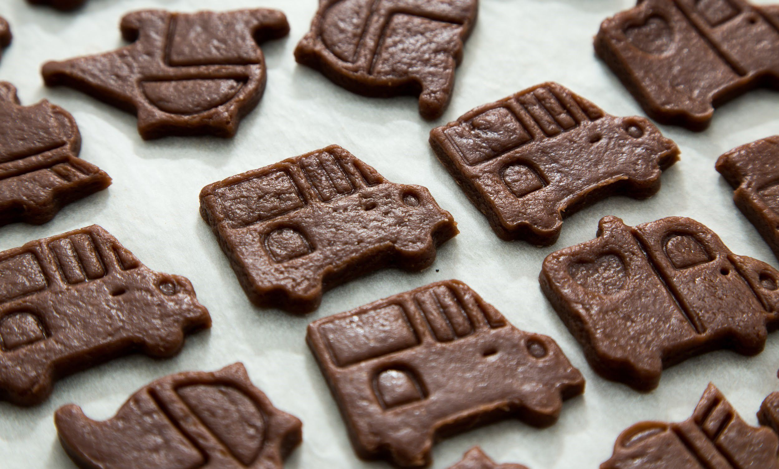 Baking tray full of car-shaped cookies