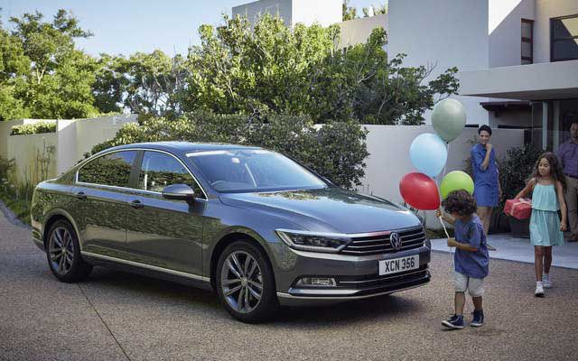 VW Passat with people and balloons