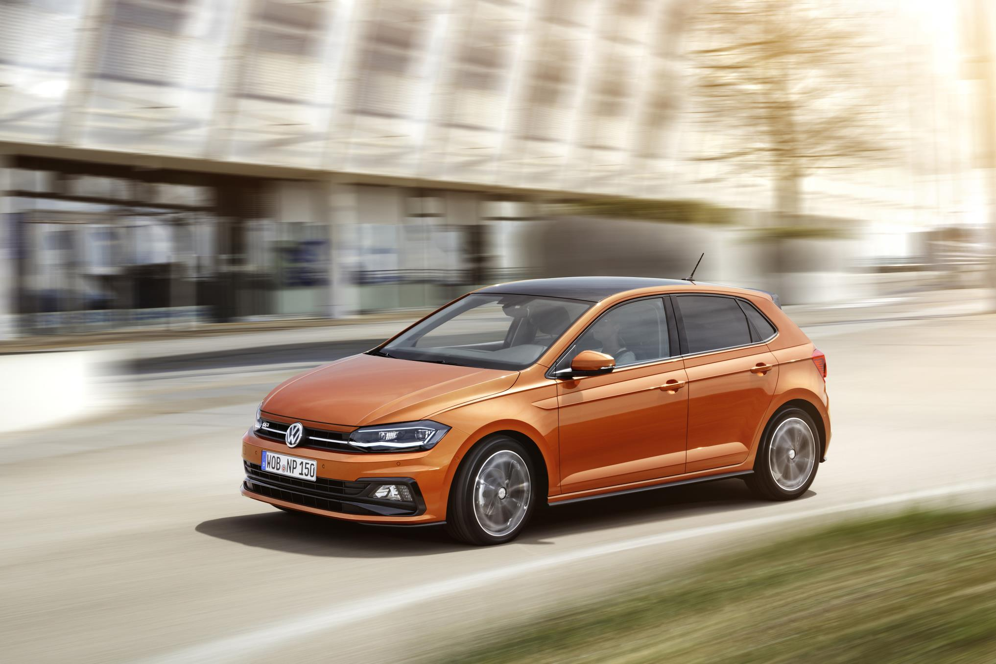 2018 Volkswagen Polo finished in orange driving