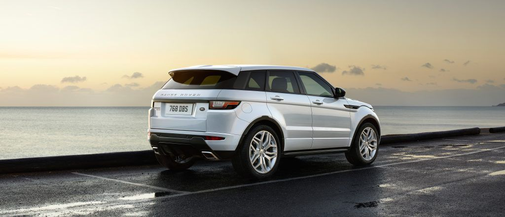 Rear view of a White Range Rover Evoque parked up by the sea