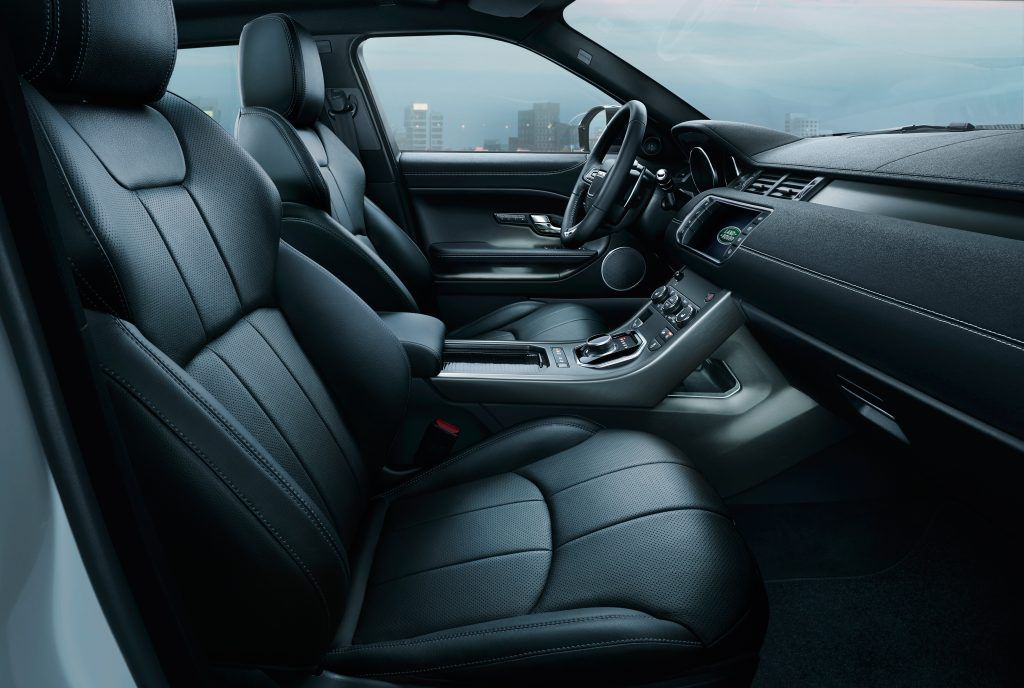 Interior of a Range Rover Evoque, Black leather seating as well as controlling and steering wheel in view