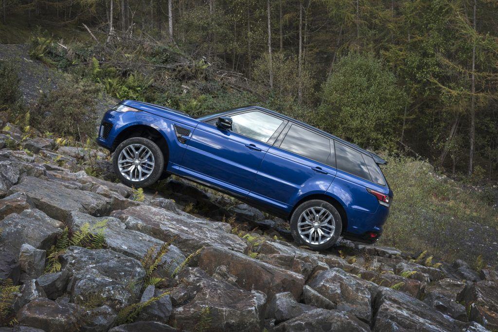 Blue Range Rover Sport Driving up a rocky mountain