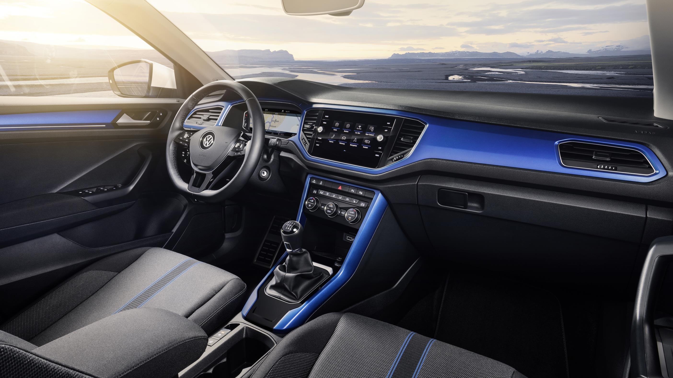 Blue trimmefd interior dashboard of VW T-Roc small SUV