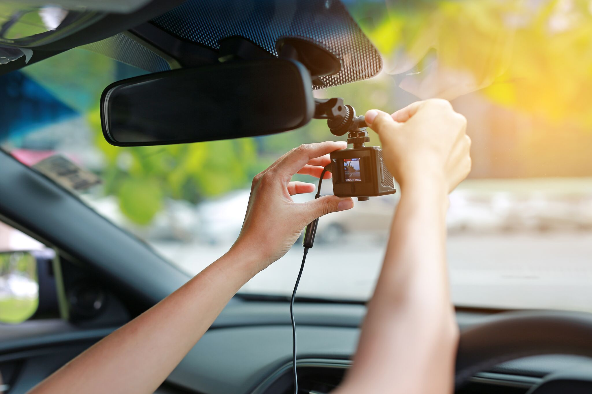 Adjusting a dash cam on your car windscreen