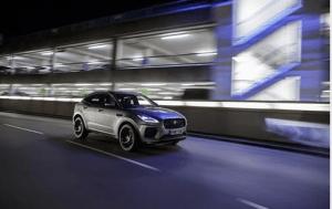 Jaguar SUV driving at night