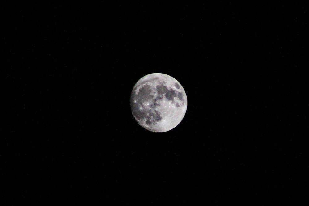 Silver moon in a dark black night