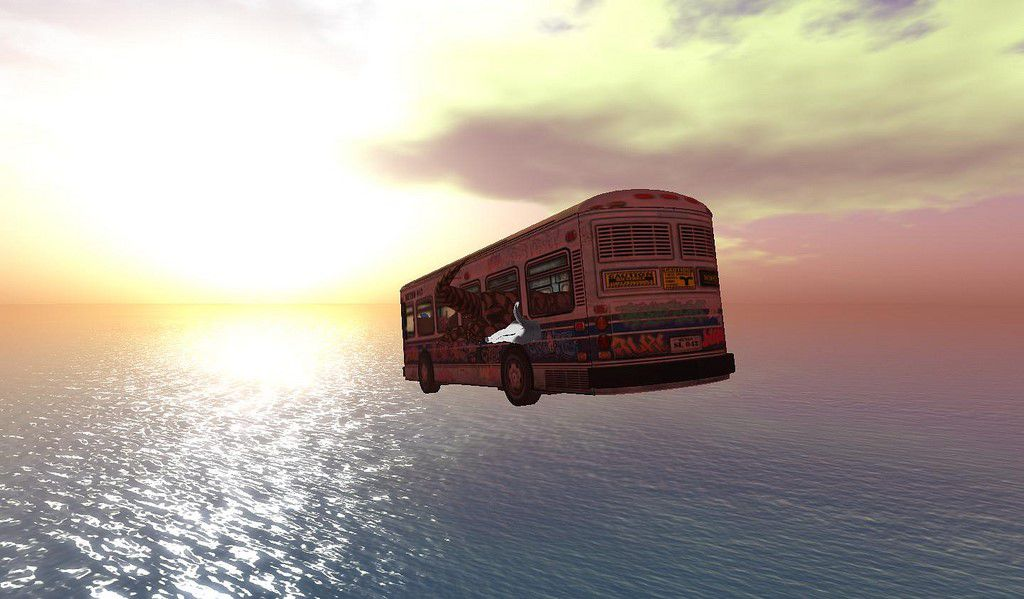 Computerised bus flying into the ocean against an orange sunset