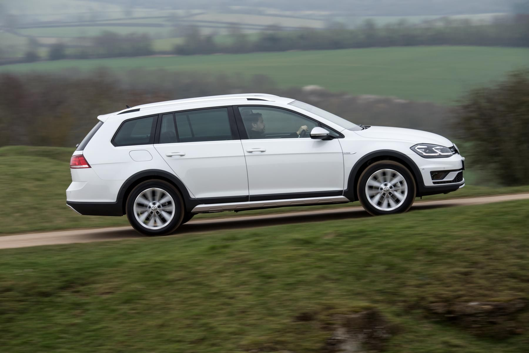 Volkswagen Golf Alltrack climbing a hill in the countryside