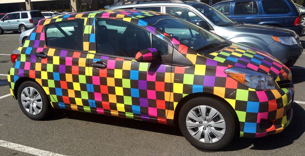 Colourful checkered car parked