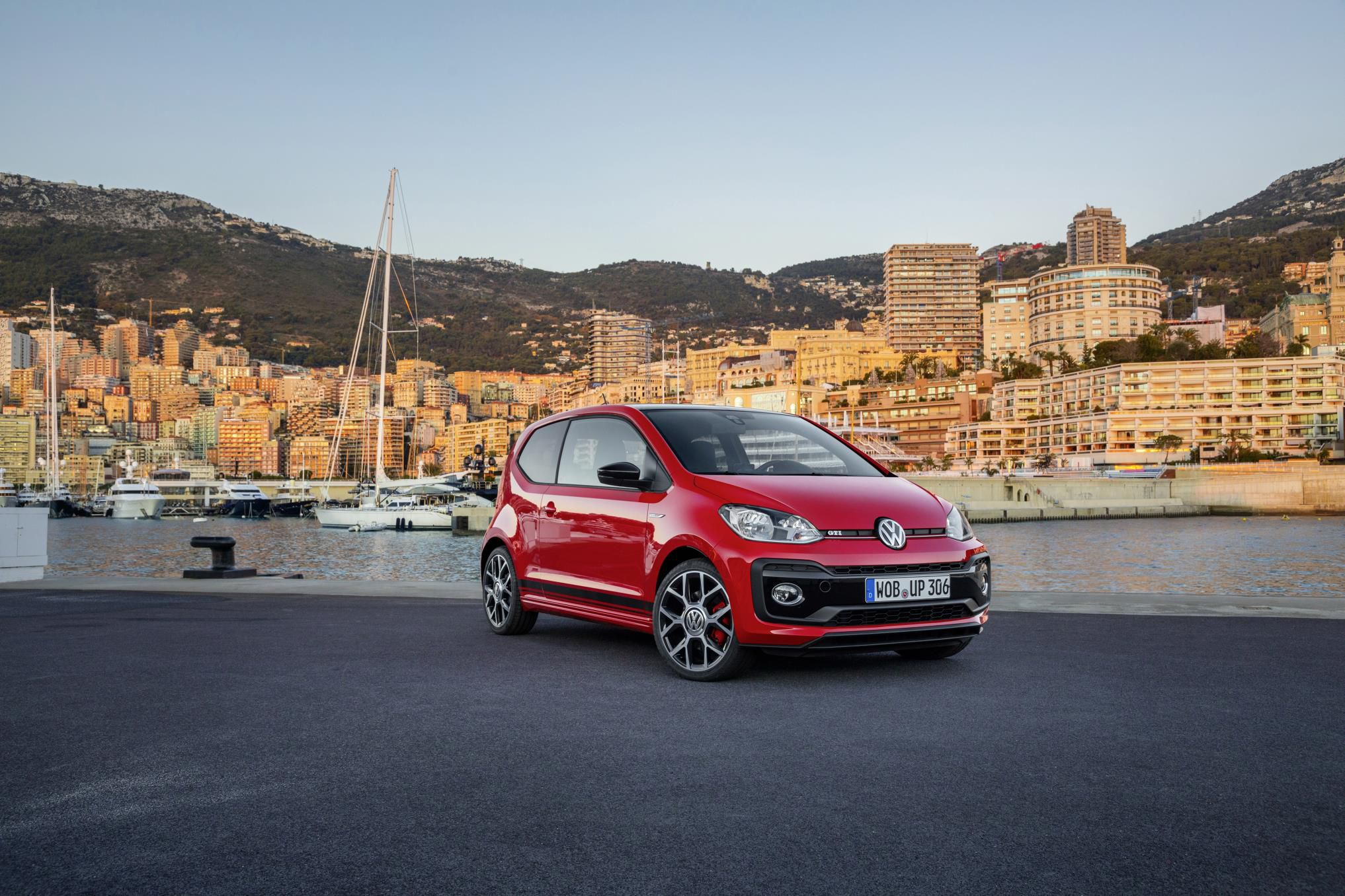 Red Volkswagen up! GTI parked at a harbour