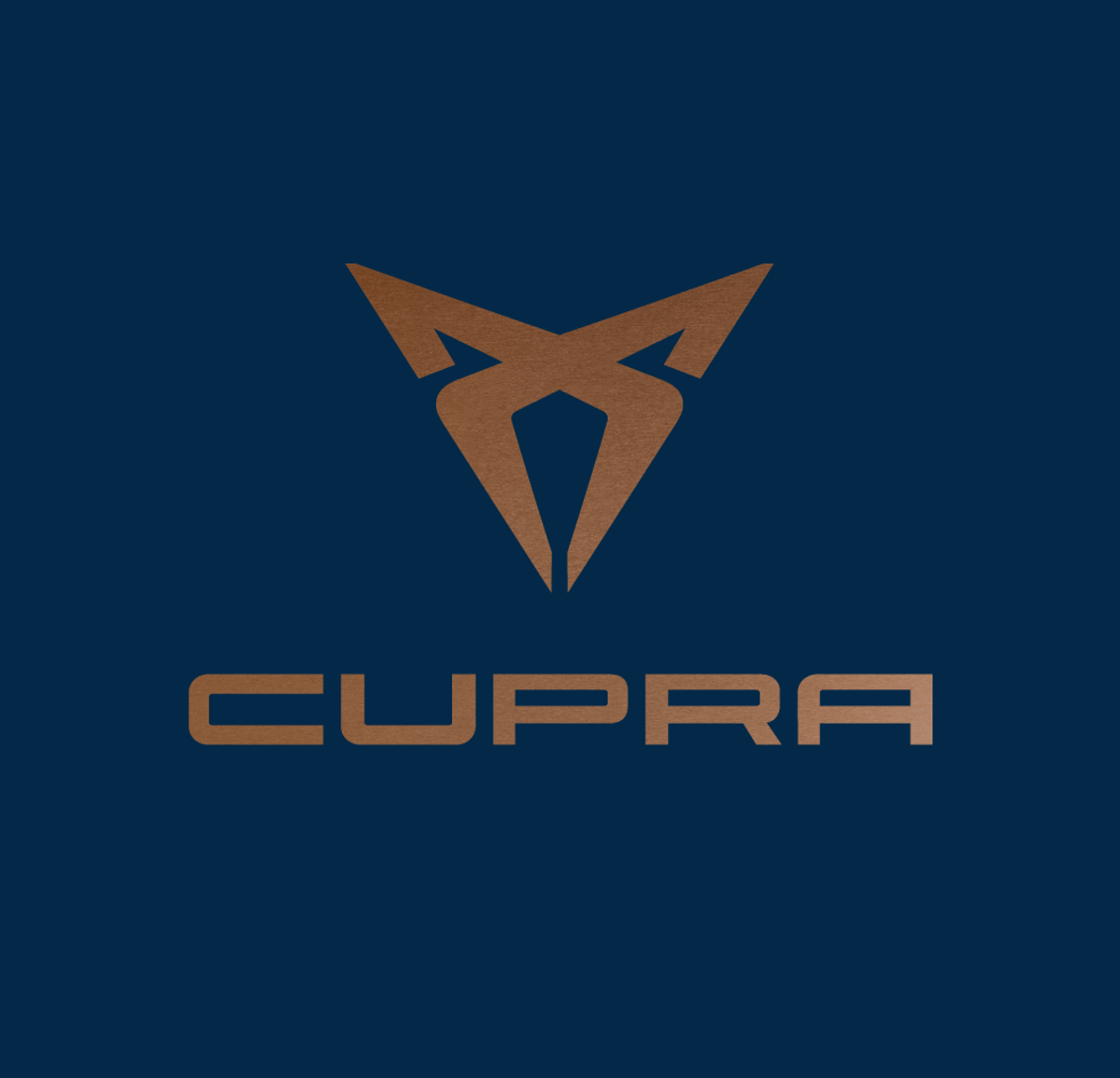 The new SEAT CUpra logo which is a gold symbol on a midnight blue background