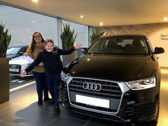 Happy mum and daughter collect brand new Audi Q3 from Carlisle Audi