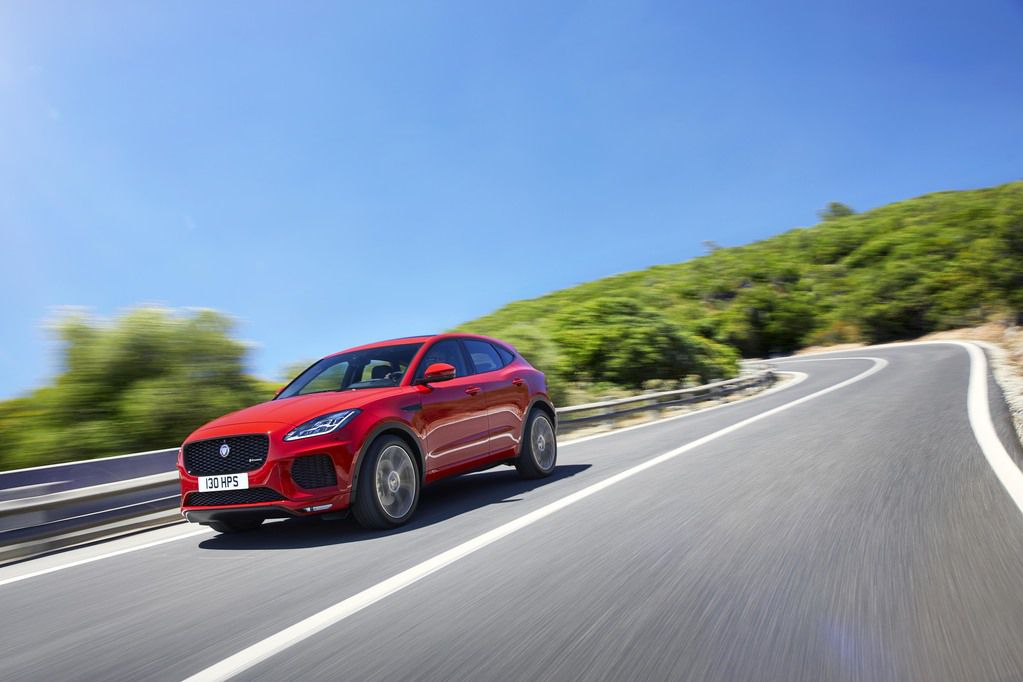 Gorgeous red Jaguar E-Pace action shot on winding road