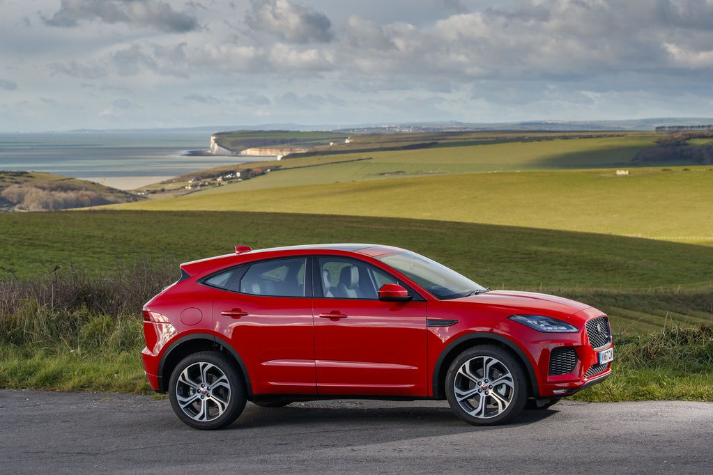 Red Jaguar E-Pace from the side in gorgeous landscape