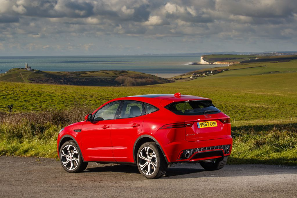 Red Jaguar E-Pace in beautiful coastal landscape, seen from the rear