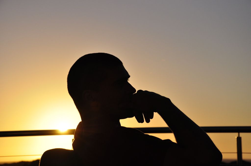 Silhouetted man thinking about the past