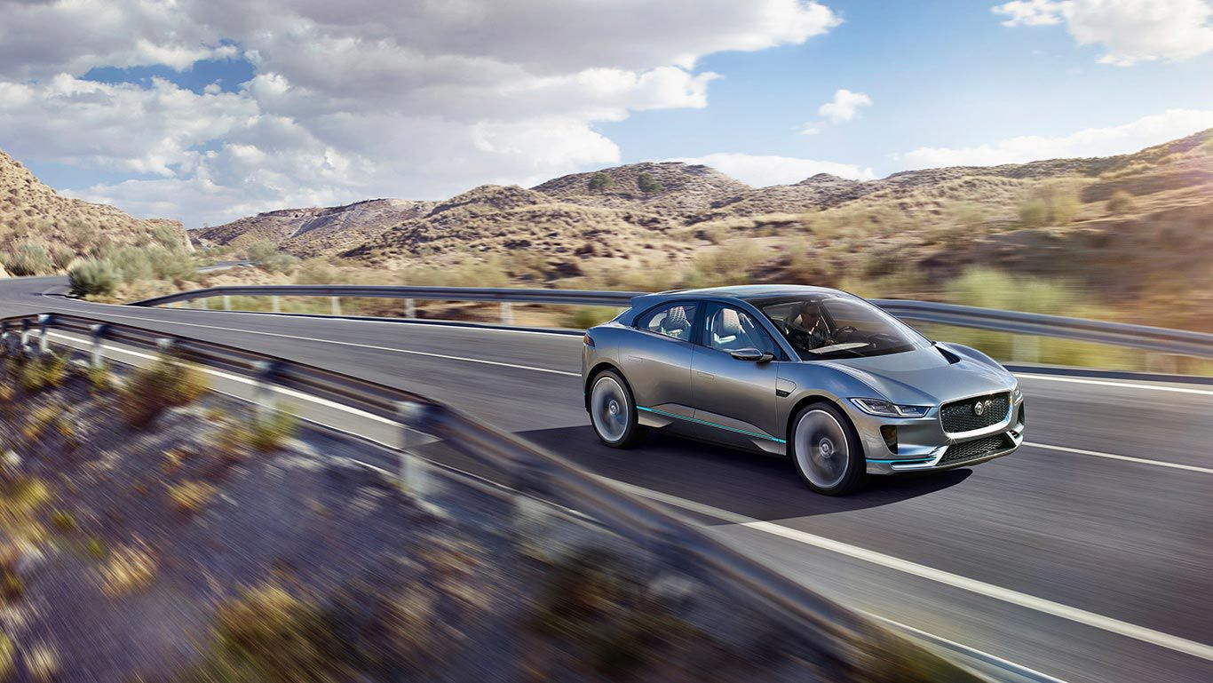 Stunnning all-electric Jaguar I-Pace speeding through countryside