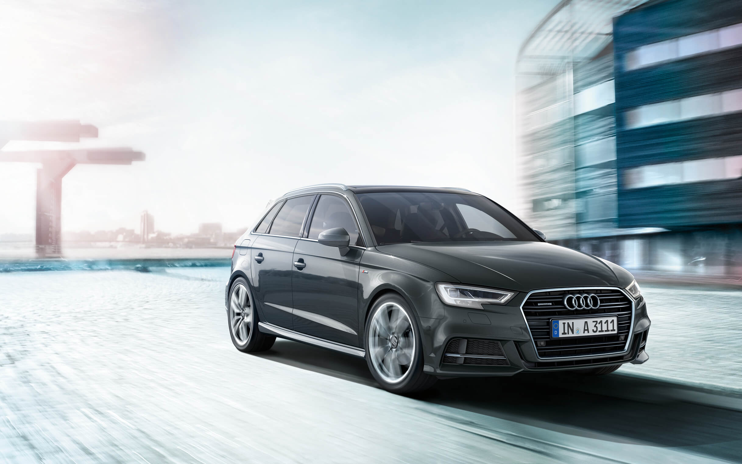 dark Audi A3 sportback against blurred background